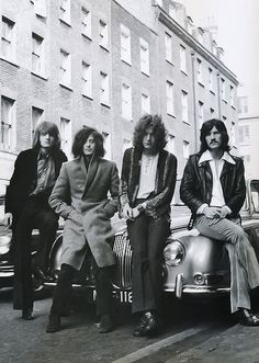 Led Zeppelin posed on a Jaguar car in London in December 1968. Photo by Dick Barnatt