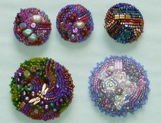 Small seed bead look to create beautiful designs on buttons. Especially like the dragonfly.