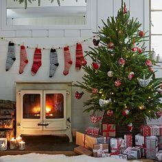 Folky living room with Christmas stockings | Country Christmas decorating ideas | PHOTO GALLERY | Country Homes and Interiors | Housetohome.co.uk