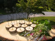 15 Table/ Menu /Place /Name Card Holders ( Rustic Wire CURL EARTHED in WOOD ). $37.50, via Etsy.