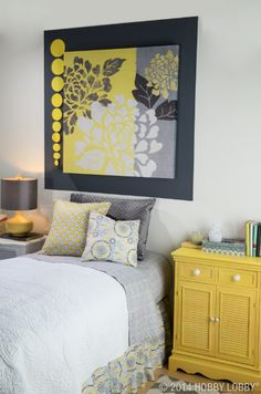 We love the contrast of cool gray with mustard yellow for a bright and sunny room!