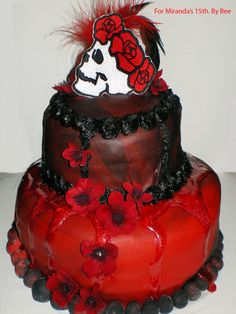 Miranda's Gothic Cake - For my little gothic sister's 15th birthday. She requested black and red. Devils food and buttercream, rolled fondant and gel.