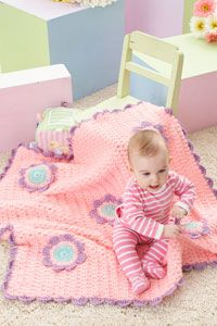 So cute for a little girls room!! Caron International | Free Project | Flowers Blanket