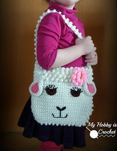 Crochet this sweet sheep purse for the little girls in your life, as an Easter gift or an all year round gift.