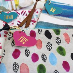 Free heart-shaped name tag with every zipper pouch purchase.