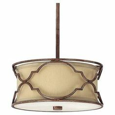 """Openwork metal pendant in bronze and gold dust with a fabric drum shade.   Product: PendantConstruction Material: Metal and fabricColor: Bronze and gold dustFeatures: UL listed for dry locationsAccommodates: (2) 40 Watt candelabra base bulbs - not includedDimensions: 46.5"""" H x 11.75"""" Diameter"""