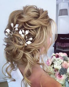 Lovely loose updo with floral metal accents!