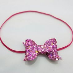 This new pink glitter bow is another favorite! It's a gorgeous mix of pink and orange, it kind of reminds me of a sunset!