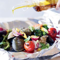 "Grilled Shellfish and Vegetables al Cartoccio Cartoccio means ""paper"" in Italian, which refers to the wrapping used to make packets for grilling. Here, foil packets preserve every drop of the delicious seafood juices for sopping up with crusty bread."