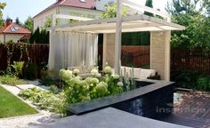 Modern garden with arbor and water fontain