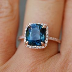 Blue Green sapphire Rose gold engagement ring. Engagement ring by Eidelprecious. This ring features a 3.6ct cushion sapphire. The color is gorgeous deep peacock blue with green flashes, SI, heated. The sapphire is very beautiful and clean, tones of sparkles! The sapphire displays color change and