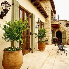 Stucco and stone  mediterranean exterior by Don Ziebell