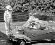 "Elvis Presley in 1956 at home in Memphis with his three-wheeled Messerschmitt ""bubble car"" and Harley-Davidson"