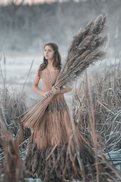 Had to throw this out there, kids.... come on... it's not something you see everyday... a girl in a wheat dress holding stalks of wheat...