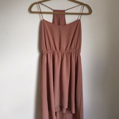 Blush Pink Hi-Low Dress Only worn once but in awesome condition! There is a small unnoticeable stain shown in pic #3.  Shell  made of 100% Polyester and lining is made of 94% Polyester and 6% Spandex. Dresses High Low
