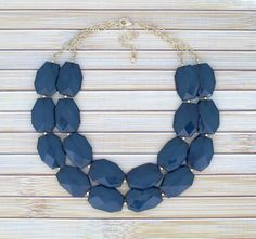 A personal favorite from my Etsy shop https://www.etsy.com/listing/223180047/navy-blue-beaded-chunky-statement