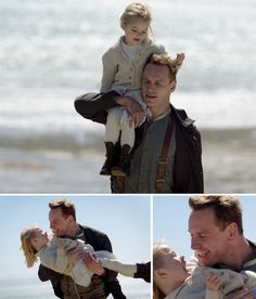 "Tom Sherbourne (Michael Fassbender) holds the child Lucy (Florence Clery) in ""The Light Between Oceans"""