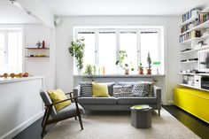 summery living room white walls green plants yellow unit and yellow cushions   Fantastic Frank