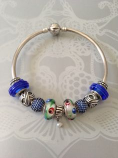 My folklore murano glass Pandora charm bangle! Nicole