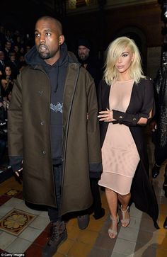Kardashian Barbie: Newly blonde Kim Kardashian looked like a doll as she stepped out in Paris with her husband Kanye West on Thursday