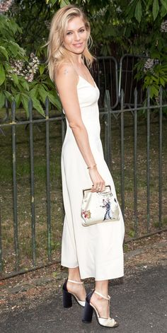 Sienna Miller was radiant at the 2016 Serpentine Summer Party in a white silk spaghetti-strap dress with T-bar sandals from the Hilfiger Collection