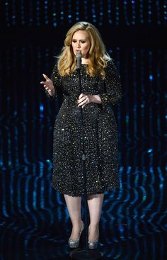 British musician Adele wearing a Burberry silk and crystal dress while performing 'Skyfall' at the Oscars in Los Angeles
