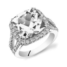 Elements Of Love 8.00 CTTW Cushion-Cut Cubic Zirconia Halo Cocktail... (17 CAD) ❤ liked on Polyvore featuring jewelry, rings, jewelry & watches, white, unisex rings, brass ring, band rings, cz jewelry and statement rings