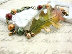 Autumn leaf bracelet. Vintage style patina oak leaf jewelry with Swarovski pearls and antiqued brass.