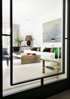 Black and white living room with small pops of color