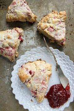 Strawberry Rhubarb Scones~ this is one of those combos that goes together like magic. Sweet and Tart and combined with the creamy goodness of a flaky, tender scone.