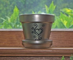 Items similar to Hand Painted Metallic Gold Clay Pot with Saucer. on Etsy Flower Pot Art, Flower Pot Design, Flower Pot Crafts, Clay Pot Crafts, Painted Clay Pots, Painted Flower Pots, Hand Painted, Painted Pebbles, Ceramic Pots