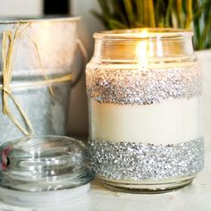 Turn a boring store bought scented candle into a glittery eye-catching housewarming gift any hostess would love!