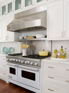Love the Viking stove! #9 Keep It Current. For a new look a few years from now, just change your cabinet hardware. Switch from subtle white-painted wood knobs to fanciful glass or ceramic accents, or try metal pulls that echo appliances, such as this range hood.