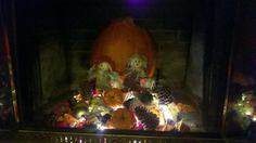 Before the temps get cold enough to enjoy a fire add some warmth and a touch of fall to you living room.A large pumpkin or 2 , some gourds and small pumpkins, some pine cones, silk fall leaves and a string of white Christmas lights ( green chord) :)