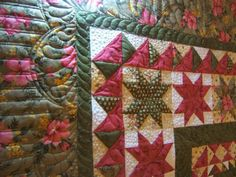 Sharon's feathered star medallion quilt