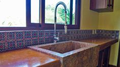 Stone sink and customized kitchen. Hacienda del Rio, RCustom rtirement homes. Playa del Carmen real estate area.