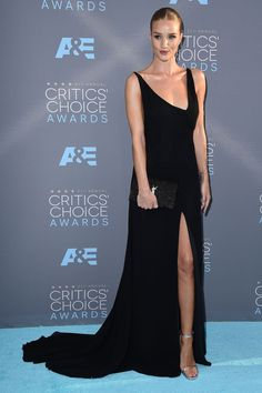 As opposed to the tough mood of its ready-to-wear line, Saint Laurent's red carpet offering blazes with fuss-free elegance. Here's Rosie Huntington-Whiteley, in all her Amazonian glory, wearing Hedi Slimane's asymmetric silk dress (which we all want to own right now) at the Critics' Choice Awards in LA.