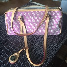 Shoulder Bag Lavender Color. Never been used. Long shoulder strap. Two inside pockets with zipper. Excellent Condition Dooney & Bourke Bags Shoulder Bags