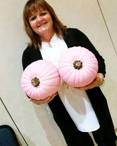 Owner Barb Daize setting up for The Life After Breast Cancer Conference with her pink pumpkins!