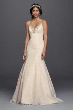 This wedding dress will bring all the romance and nostalgia you were looking for on that treasured day. From the all-over lace mermaid trumpet gown showing off your figure superbly to the sparkling crystal and bead embellishments outlining the v-neck and spaghetti straps, it all adds to the feminine air.  Jewel, exclusively at David's Bridal.  Also available in Regularand Extra Length. Check your local stores for availability.  Sweep train. Fully lined. Back zipper. Imported. Dry