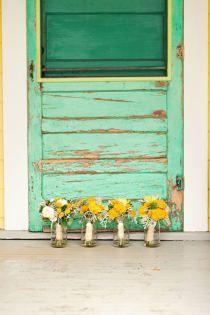 yellow flowers and teal door ...