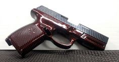 red carbon fiber hydro dipped pistol from Advanced Coatings of Redmond Oregon