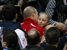 Yulia Lipnitskaya of Russia's figure skating team is greeted Russia's President Vladimir Putin at the Sochi 2014 Winter Olympics, February 9...