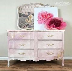 Pink Love! This beautiful dresser was finished by Annie Sloan Stockist Rachelle Fleming of Originally Worn in Macon, MO. Painted in a watercolor fashion with Chalk Paint®️️, she used Pure White, Antoinette, Henrietta, and Gold leaf to create a piece that is as unique as it is gorgeous!