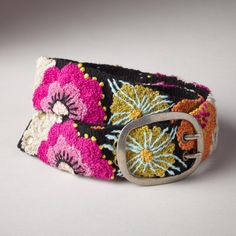 """FREDA'S FLOWER BELT--Bold, artist-inspired blooms add a touch of sunny color to brighten up the grayest days. Jenny Krauss wool flower belt. Wool. Dry clean. Imported. Sizes S (32""""), M (34""""), L (36""""). Approx. 2""""W."""