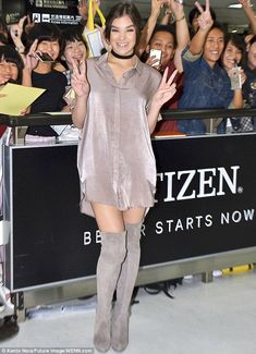 Looking V-ery nice: Hailee Steinfeld flashed peace signs and her thighs in Japan on Sunday...