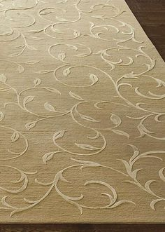 Bring new life to your home with the Tibetan Floret Wool Area Rug that features an intricate, natural design.