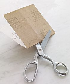 Hone Scissors With Sandpaper  Original purpose: Smoothing splinters.  Aha! use: Sharpening shears. To hone dull blades in a pinch, just snip a piece of sandpaper a few times.   Reward: Scissors cut paper.