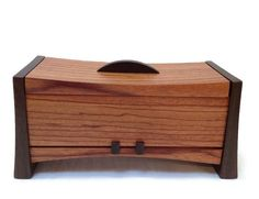 """Crafted from Ebiara and Wenge, this box would look gorgeous in any room. This hinged lid box measures approximately 10"""" wide and 5"""" tall"""