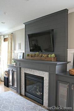 Thriftydecorchick.blogspot.com Plank wall fireplace
